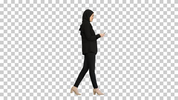 Thumbnail for Pretty woman in hijab walking and counting money, Alpha Channel