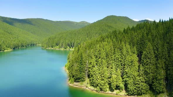Aerial view of blue lake and green forests. Fresh water. Lake Baikal. Green Forest