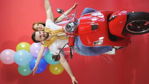 Balloon Delivery Service, a Courier Couple on a Scooter Will Deliver the Holiday and Balloons To the