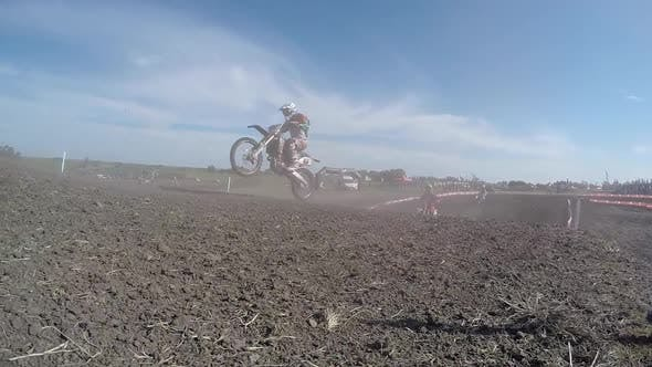 Thumbnail for Men racing in a motocross motor sports race.