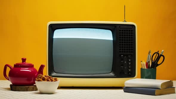 Closeup of Old Retro Television on Orange Background