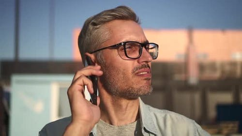 Man Portrait Phone Talking While Standing on City Street Spbd