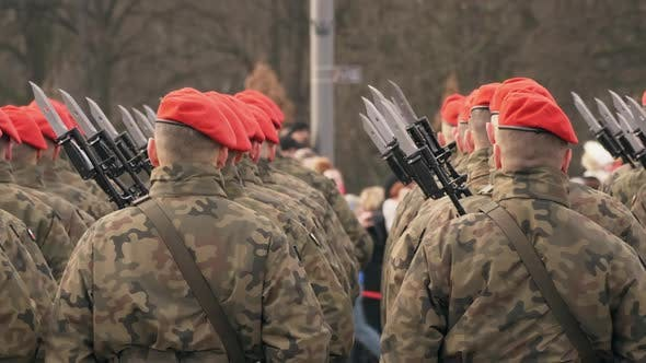 Thumbnail for A Lot of Soldiers in Red Berets and Green Uniform Stand with Their Backs To the Camera