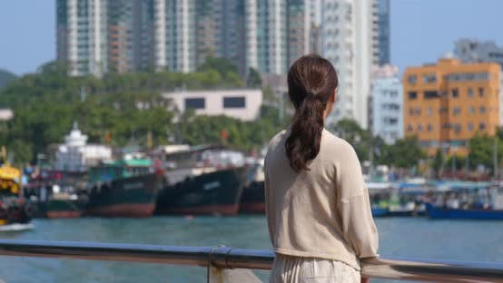 Thumbnail for Tourist woman enjoy the view of Hong Kong city with seaside