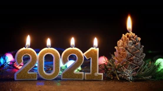 New Year's Figures 2021 with a Candle.