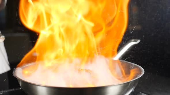 Thumbnail for Chef Making Steak Fillet Mignon in Flambe Style on a Grill Pan. Cooking in Restaurant in Slow Motion