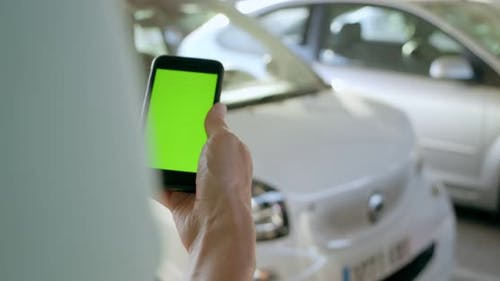 Man Opens Rental Electric Sharing Car with Phone