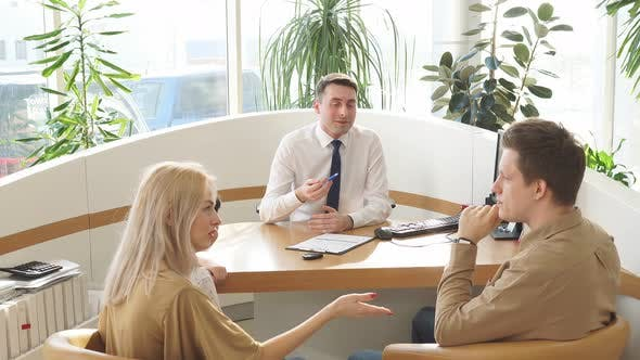 Pleasant Consultant of Dealership Talk To Customers.