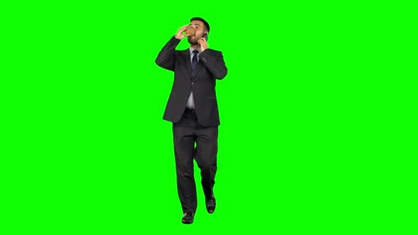Thumbnail for Businessman Walking Drinks Coffee and Talking on Smartphone Isolated Green Screen Background.