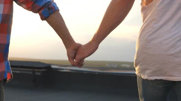 Thumbnail for Camera Follow To Gay Couple Runs on Roof and Holding Hands of Each Other at Evening Time
