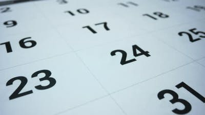 Business Calendar for Event Planning. Female Hand Marking Date on Calendar