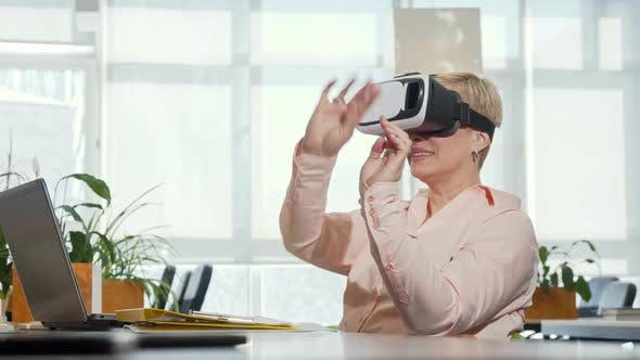 Thumbnail for Mature Businesswoman Trying 3d Virtual Reality Glasses at Her Workplace