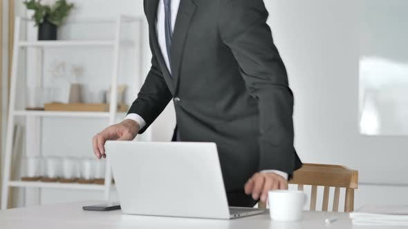 Thumbnail for Businessman Leaving Office After Closing Laptop at Work