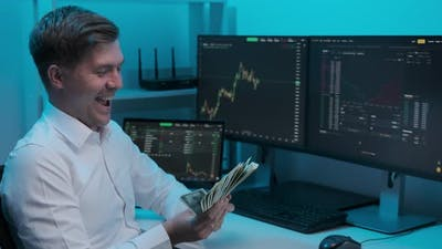 Businessman analyzing a graphic of a stock exchange chart. young male businessman accounts