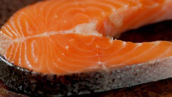 Raw Salmon Steak on the Table.