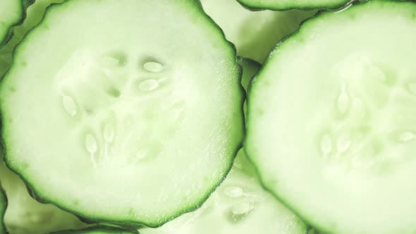 Slow Motion of Rotation Ripe Green Sliced Cucumbers