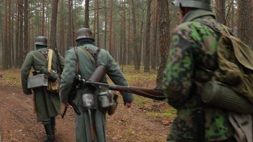 Historical Re-enactment. Re-enactors German Wehrmacht Infantry Soldier In World War II Marching