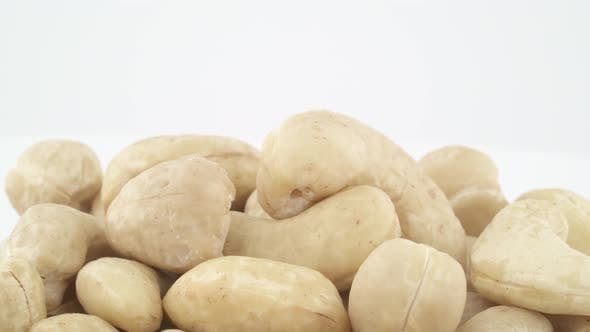 Thumbnail for Shooting of Upper Part of Cashews Heap. Rotating on the Turntable. Isolated on the White Background