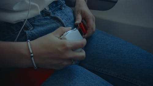 Young Woman Fasten Red Seat Belt for Flight Safety