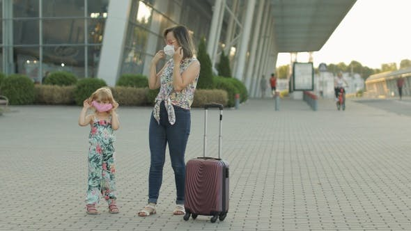 Thumbnail for Coronavirus Pandemic, Covid-19 Ended. Daughter and Mother Tourists Takes Off Medical Mask. Vacations