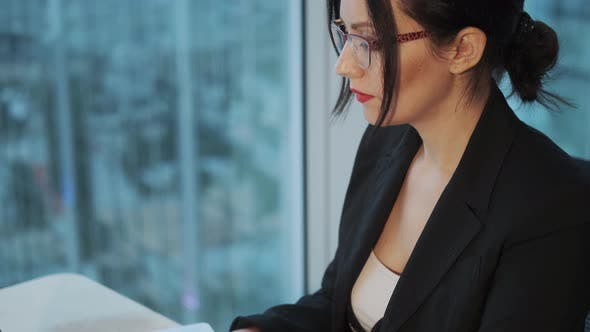 Thumbnail for Portrait of a Young Business Woman Working at a Computer in a Modern Office