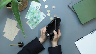Hands open empty wallet