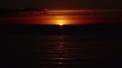 Setting Sun Reflects on Lagoon Creating Sunlight Path