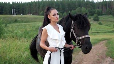 Professional Model Brunette Holds Black Stallion Bridle