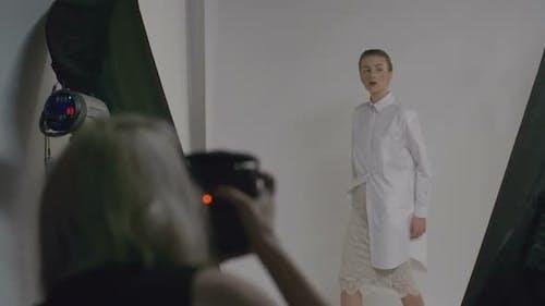 Model Posing for Camera