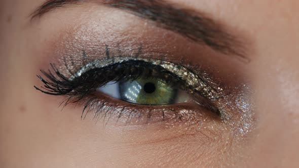 Thumbnail for Extreme Close Up of Human Eye Iris in Video. Female with Beautiful Makeup, Glitter Shadows and False