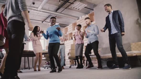 Multiethnic Business People Celebrate Business Sucess at Teambuilding Casual Dance Party in Modern