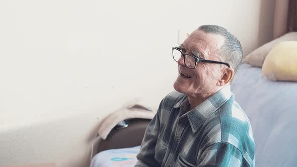 Cover Image for Portrait of an Elderly Man Wearing Glasses, He Laughs