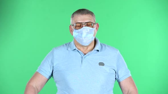 Portrait of Aged Man Takes Off His Medical Disposable Mask and Takes a Deep Breat, Isolated Over