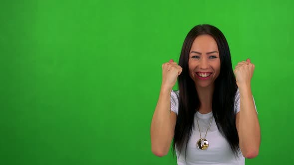 Thumbnail for Young Pretty Woman Rejoices - Green Screen - Studio