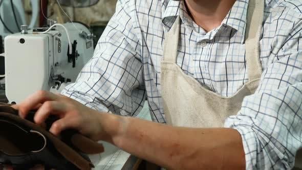 Thumbnail for Male Shoemaker Polishing Shoes at His Workshop 1080p
