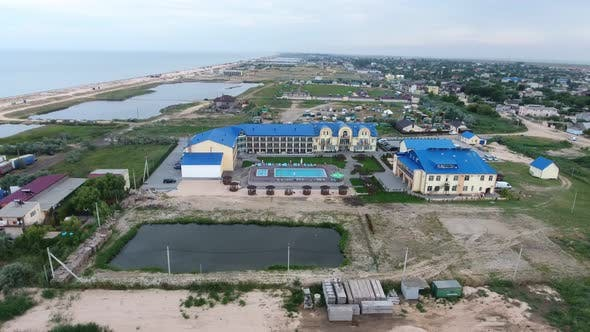 Thumbnail for Aerial Shot of a Big Hotel Complex with a Swimming Pool on a Sea Resort in Sumer