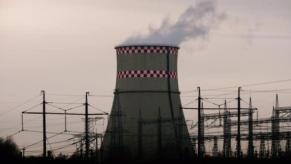 Cover Image for Industrial Zone Thermal Power station exhaust steam in the air, smoking pipe electric power Line