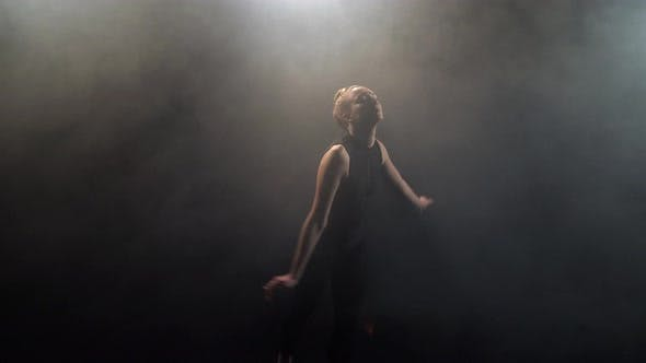 Thumbnail for Feminine Actress During Dance on Smoky Black Stage