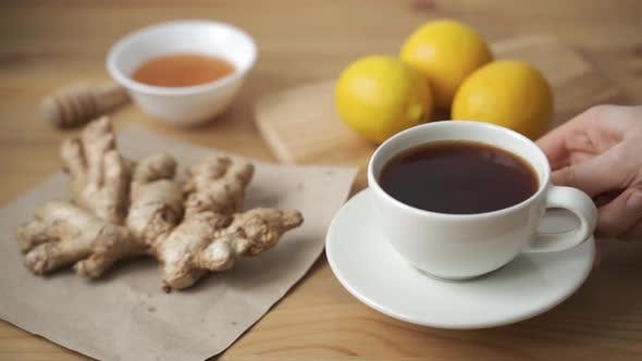 Closeup of Pouring Freshly Brewed Vitamin Tea with Ginger and Lemon