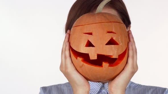 Thumbnail for Woman Hiding Behind Carved Halloween Pumpkin Isolated