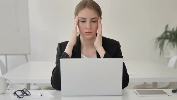Thumbnail for Stressed Young Businesswoman with Headache Working on Laptop
