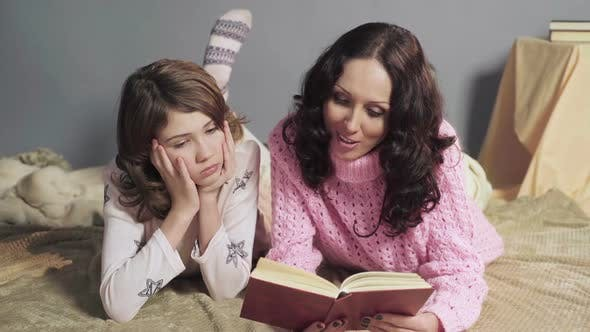 Cover Image for Mother Reading Aloud Interesting Storybook to Her Daughter Family Values