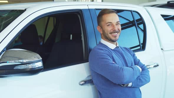 Thumbnail for A Happy Man Is Leaning on His New Car