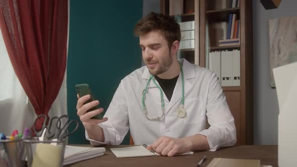 Doctor Wearing Medical Gown Consultation Video Conference in Video Chat Medical App