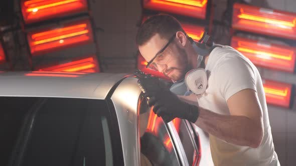 Thumbnail for Man Checks Result of Polishing of Car with a Flashlight