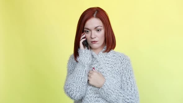 Thumbnail for Emotionally Red Haired Woman Wearing Cozy Gray Sweater Talking at Call Phone
