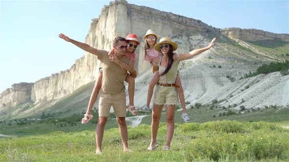 Cover Image for Happy Family of Four Walking in the Mountains