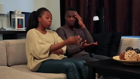 Thumbnail for Young Black Unhappy Couple Watch Television in Living Room and They Are Angry