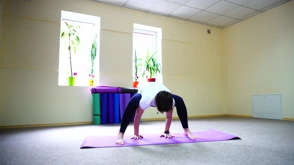 Thumbnail for Beautiful Young Woman with Dark Haired Performs Yoga Exercises