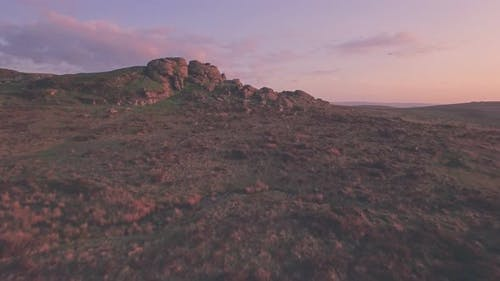 Dartmoor National Park scenery at sunset, Devon, England, UK. Aerial drone view